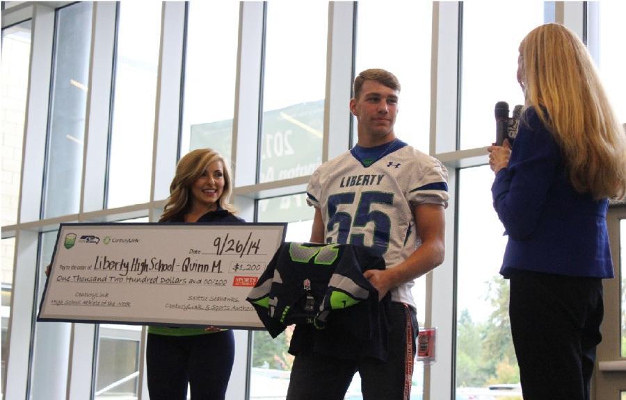 Liberty scholar-athlete receives raucous recognition